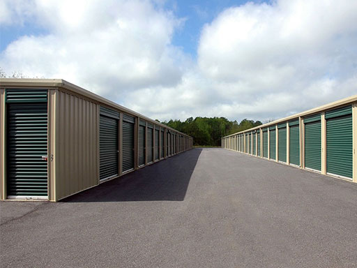 Rows of outdoor storage units with green doors
