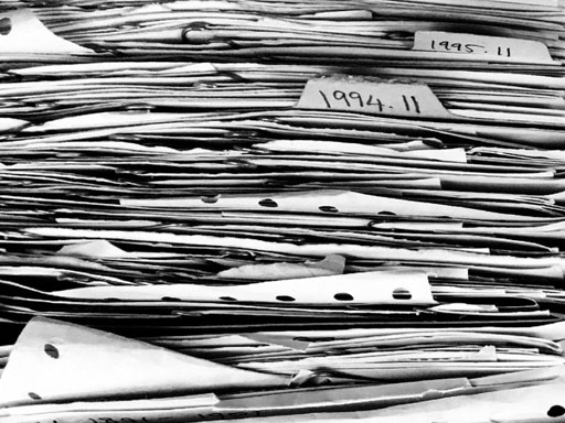 Black and white stack of papers