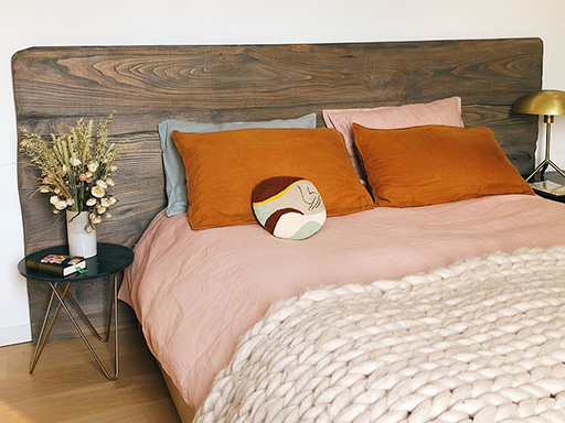 Bohemian bedroom with pink bead and chunky knit blanket