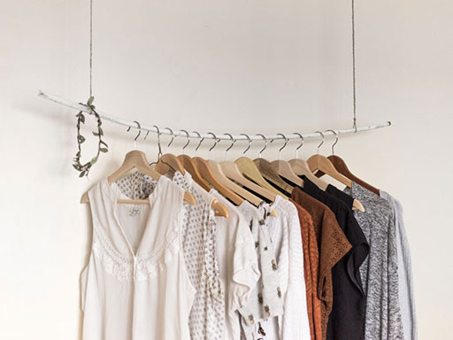 Women's blouses hanging on a metal rack
