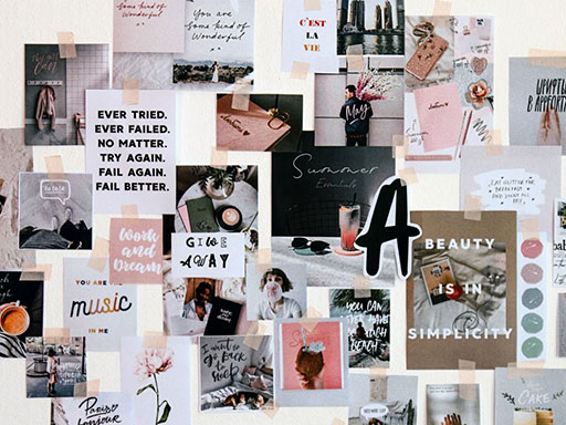 Inspirational posters taped to a white wall