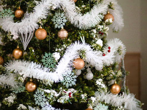 Decorated Christmas tree with cold ornaments and snowflakes